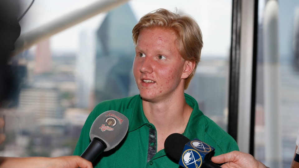 Rasmus Dahlin, of Sweden, talks to the media in Dallas, Thursday, June 21, 2018. (AP Photo/Michael Ainsworth)