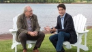 Prime Minister Justin Trudeau chats with Premier Wade MacLauchlan in Cardigan, P.E.I. on Thursday, June 29, 2017. THE CANADIAN PRESS/Andrew Vaughan