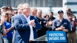 Ontario premier-designate Doug Ford announces his commitment to keeping the Pickering Nuclear Generating Station in operation until 2024 in Pickering, Ont., on Thursday, June 21, 2018. THE CANADIAN PRESS/Nathan Denette