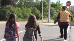 Crossing guard, Michelle Tremblett helps kids cross the street safely