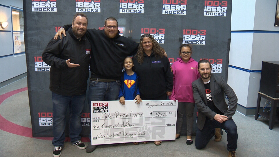 The Covino family receives a $5,000 cheque from 100.3 The Bear on Friday, June 22, 2018.