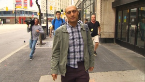 Selim Esen's brother, Omer, arrives at a Toronto courthouse on June 22, 2018.