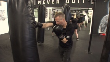 Andrew Coombes, a youth outreach worker, participates in the Frontline Fight Club.