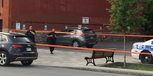 Montreal police officers block off a scene in Griffintown after a six-month-old baby was found dead in a vehicle on Friday, June 22, 2018. (Source: Max Harrold, CTV Montreal)