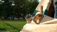 Police officers help erect tipi at Saskatoon park