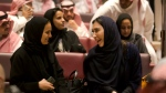 Visitors laugh as they attend a cinema at an invitation-only screening, at the King Abdullah Financial District Theater, in Riyadh, Saudi Arabia, Wednesday, April 18, 2018. (AP Photo/Amr Nabil)