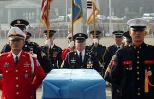 In this Friday, Feb. 14, 2003, United Nations Command soldiers stand around the coffin of one Korean War-era remains during an honor guard departure ceremony, at Yongsan U.S. Army Base in Seoul, South Korea. (AP Photo/Yun Jai-hyoung, File)