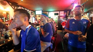 Iceland soccer fans watch the final minutes on television of the team's loss to Nigeria in a World Cup soccer match at a sports bar, Friday, June 22, 2018, in Seattle. (AP Photo/Elaine Thompson)