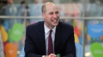 In this Jan. 18, 2018 file photo, Prince William, laughs while with military veterans now working for the National Health Service as he visits Evelina London Children's Hospital in London. (AP Photo/Daniel Leal Olivas, Pool)