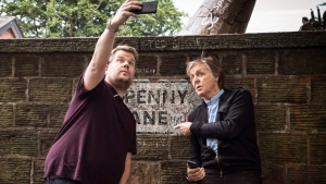 "In this image released by CBS, Paul McCartney, right, joins host James Corden as they take a selfie on Penny Lane during the ""Carpool Karaoke"" segment on ""The Late Late Show with James Corden."" (Craig Sugden/CBS via AP)"