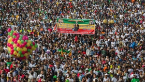 Ethiopians rally in solidarity with Prime Minister Abiy Ahmed, whose photograph is seen on banner, in Meskel Square in the capital, Addis Ababa, Ethiopia Saturday, June 23, 2018. A deadly explosion struck the huge rally for Ethiopia's reformist new prime minister on Saturday shortly after he spoke and was waving to the crowd that had turned out in numbers unseen in recent years in the East African nation. (AP Photo/Mulugeta Ayene)