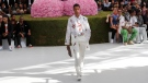 A model wears a creation as part of Dior Men's Spring-Summer 2019 fashion collection presented in Paris, Saturday June 23, 2018. (AP Photo/Christophe Ena)