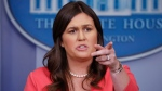 White House press secretary Sarah Huckabee Sanders gestures while speaking to the media during the daily briefing in the Brady Press Briefing Room of the White House, Monday, June 18, 2018. (AP Photo/Pablo Martinez Monsivais)