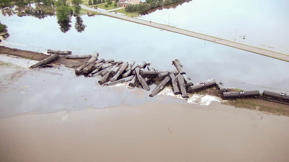 In this aerial drone image taken from video and provided by the Sioux County Sheriff's Office, tanker cars carrying crude oil are shown derailed about a mile south of Doon, Iowa, Friday, June 22, 2018. (Sioux County Sheriff's Office via AP)