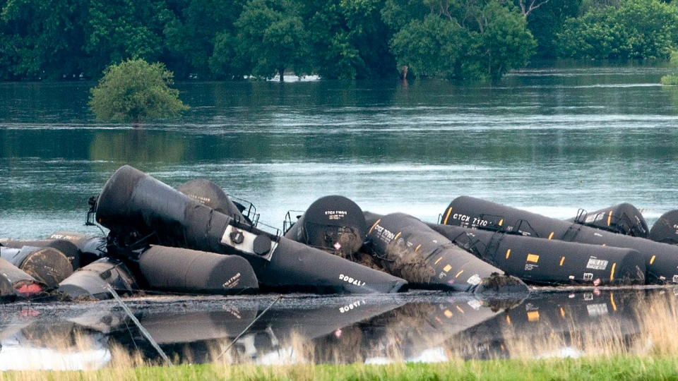 Tank cars carrying crude oil are shown derailed about a mile south of Doon, Iowa, Friday, June 22, 2018. (Tim Hynds/Sioux City Journal via AP)