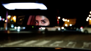 Hessah al-Ajaji drivers her car down the capital's busy Tahlia Street after midnight for the first time in Riyadh, Saudi Arabia, Sunday, June 24, 2018. (AP Photo/Nariman El-Mofty)