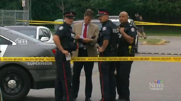 Police investigate near the scene of a fatal stabbing in Toronto, on Saturday, June 23, 2018.