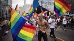 People take part in the Pride parade in Toronto, Sunday, June 25, 2017. (THE CANADIAN PRESS/Mark Blinch)