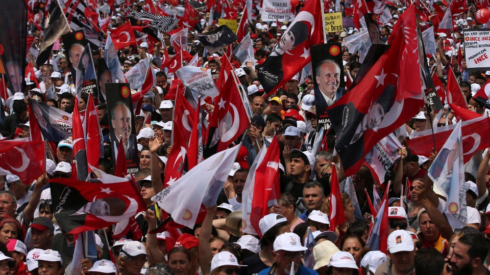 Supporters of Muharrem Ince, presidential candidate of Turkey's main opposition Republican People's Party wave flags during an election rally in Istanbul, Saturday, June 23, 2018.  (AP Photo/Emrah Gurel)