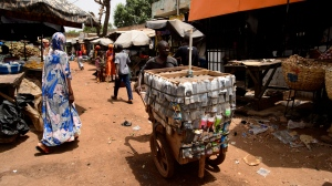 People make their way through the streets of Bamako, Mali, Africa on Saturday, June 23, 2018. THE CANADIAN PRESS/Sean Kilpatrick