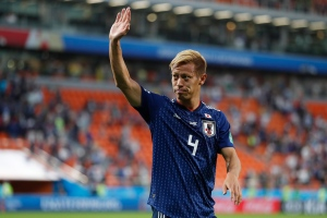 Japan's Keisuke Honda celebrates at the end of the group H match between Japan and Senegal at the 2018 soccer World Cup at the Yekaterinburg Arena in Yekaterinburg , Russia, Sunday, June 24, 2018. Japan and Senegal tied 2-2. (AP Photo/Natacha Pisarenko)
