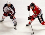 Chicago Blackhawks center Tanner Kero, right, shoots against Columbus Blue Jackets center Brandon Dubinsky during the third period of an NHL hockey game Friday, March 31, 2017, in Chicago. (AP Photo/Nam Y. Huh)