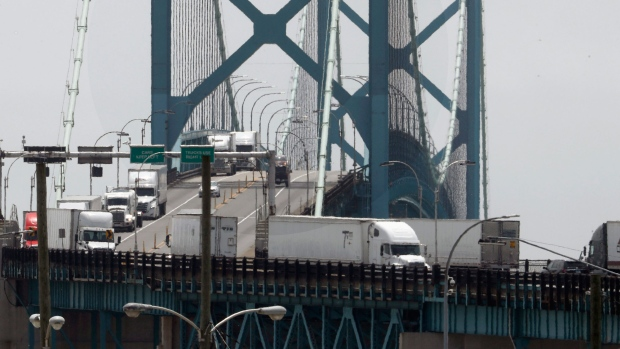 In this Tuesday, June 12, 2018, photo, trucks cross the Ambassador Bridge from Windsor, Ontario into Detroit. In nearly a quarter-century since NAFTA was approved, a complex chain of automotive parts makers has sprung up on both sides of the U.S.-Canada border. About 7,400 trucks cross the bridge between Detroit and Windsor every day, many laden with auto parts. (AP / Paul Sancya)