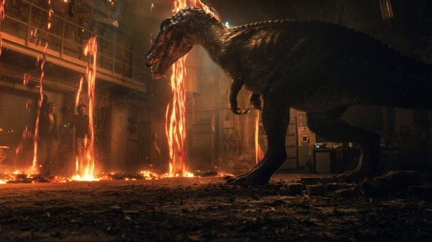 """This image released by Universal Pictures shows Bryce Dallas Howard, left, and Justice Smith in a scene from the upcoming """"Jurassic World: Fallen Kingdom."""" (Universal Pictures via AP)"""