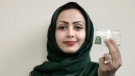 In this June 23, 2018 photo, 34-year old Asmaa al-Assdmi poses for a photograph holding her new car license at the Saudi Driving School inside Princess Nora University in Saudi Arabia. (AP / Nariman El-Mofty)