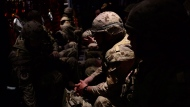 The first Canadian troops make their way to a UN base in Gao, Mali, on Sunday, June 24, 2018., aboard a Hercules aircraft. THE CANADIAN PRESS/Sean Kilpatrick