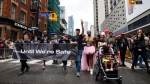 As a tribute to those lost from the community, people march with We Will Not Rest #UntilWe'reSafe posters and t-shirts during Toronto Pride parade on Sunday, June 24, 2018 in Toronto. THE CANADIAN PRESS/Cole Burston