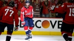 Washington Capitals defenseman John Carlson, center, celebrates with teammates after scoring a goal against the Vegas Golden Knights during the second period in Game 4 of the NHL hockey Stanley Cup Final, Monday, June 4, 2018, in Washington. (AP Photo/Alex Brandon)