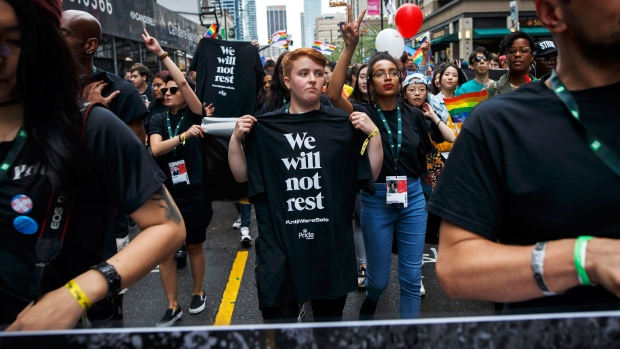As a tribute to those lost from the community, people march with We Will Not Rest #UntilWe'reSafe posters and t-shirts during Toronto Pride parade on Sunday, June 24, 2018 in Toronto. (THE CANADIAN PRESS/Cole Burston)