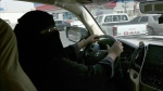 Mabkhoutah al-Mari drives to work for the first time in Riyadh, Saudi Arabia, Sunday, June 24, 2018. (AP Photo/Nariman El-Mofty)