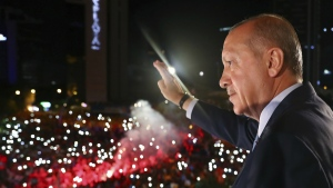 Turkey's President Recep Tayyip Erdogan, waves to supporters of his ruling Justice and Development Party (AKP) in Ankara, Turkey, early Monday, June 25, 2018. (Presidency Press Service via AP, Pool)