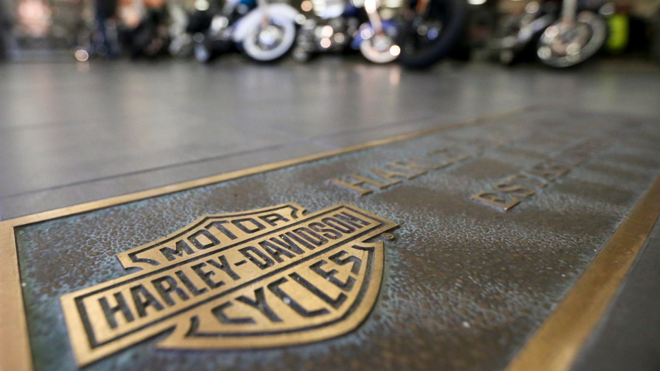 In this April 26, 2017, file photo, rows of motorcycles are behind a bronze plate with corporate information on the showroom floor at a Harley-Davidson dealership in Glenshaw, Pa. (AP Photo/Keith Srakocic, File)