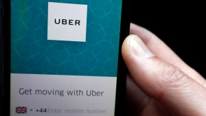 In this Friday, Sept. 22, 2017 file photo, an Uber App is displayed on a phone in London.(AP Photo/Kirsty Wigglesworth, file)