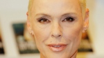 Danish actress Brigitte Nielsen launches her autobiography, You Only Get One Life, at the London Book Fair, Earl's Court Exhibition Centre, London, Monday, April 11, 2011. (AP Photo/Joel Ryan)