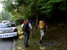 Family, friends and search and rescue personnel scour the North Shore mountains in search of Daniel Hughes. June 13, 2009. (CTV)