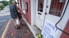Passersby examine the menu at the Red Hen Restaurant Saturday, June 23, 2018, in Lexington, Va. (AP Photo/Daniel Lin)/Daily News-Record via AP)