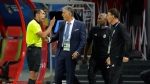 In this file photo from June 20, 2018, Iran head coach Carlos Queiroz, second left, talks to an assistant referee during the Group B match between Iran and Spain at the World Cup in Kazan, Russia, Spain won 1-0. (AP Photo/Sergei Grits)