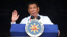 In this Tuesday, June 11, 2018, file photo, Philippine President Rodrigo Duterte gestures while addressing the crowd at the 120th Philippine Independence Day celebrations south of Manila, Philippines. (AP Photo/Bullit Marquez, File)