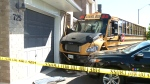 School bus crashes into home