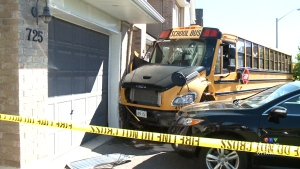 School bus crashes into home