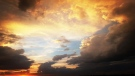Storm clouds versus the sunset over our pasture in Gladstone. Photo by Angie Gomez.