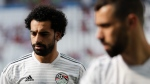 Egypt's Mohamed Salah walks on the pitch during warm up before the group A match between Saudi Arabia and Egypt at the 2018 soccer World Cup at the Volgograd Arena in Volgograd, Russia, Monday, June 25, 2018. (AP Photo/Andrew Medichini)