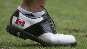 Alena Sharp is seen with a Canadian flag on her golf shoe at the Canadian Pacific Women's Open LPGA golf tournament at the Vancouver Golf Club in Coquitlam, B.C., on Thursday, August 20, 2015. (THE CANADIAN PRESS/Jonathan Hayward)