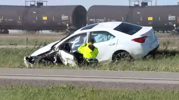 A damaged sedan west of Coalhurst following Monday afternoon's fatal head-on collision on Highway 3