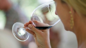 In this June 7, 2008 file photo, a woman evaluates the aroma of a wine in California. (AP Photo/Eric Risberg, File)