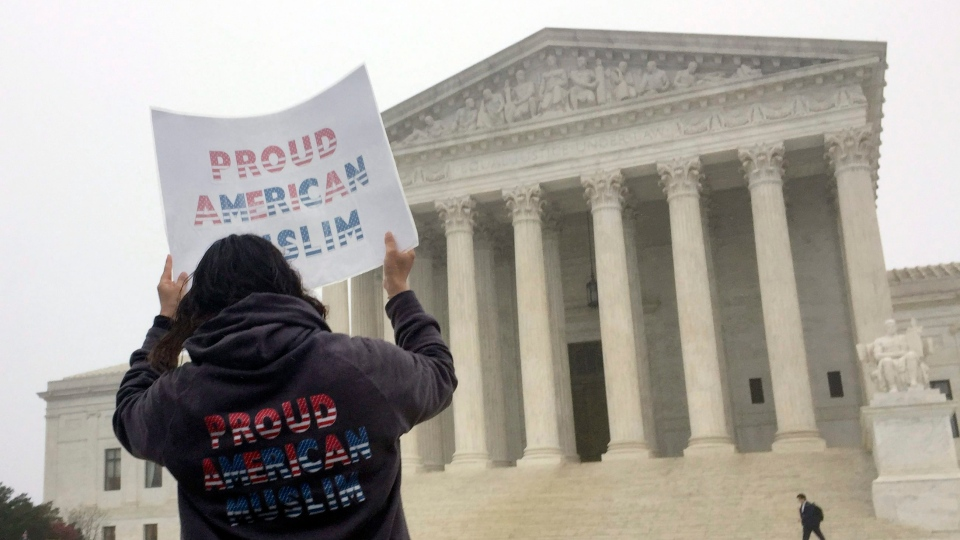 Seema Sked, 39, of Richmond, Va, demonstrates outside the Supreme Court ahead of arguments over President Donald Trump's travel ban on Wednesday, April 25, 2018, in Washington. (AP Photo/Jessica Gresko)
